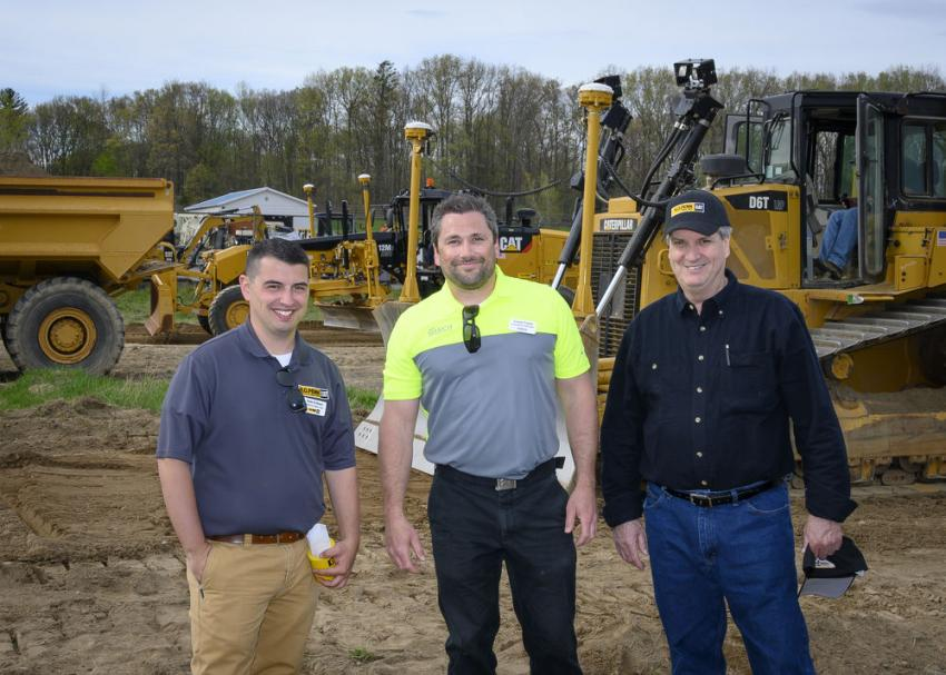 (L-R): Dale Eriksen, machine sales representative from Newington, Conn.; Corey Freed, operations manager of SITECH in Allentown, Pa.; and James Sherry of Lucyk Contracting in Mountain Dale, N.Y., in the testing field where attendees are able to try out several types of Cat machinery.