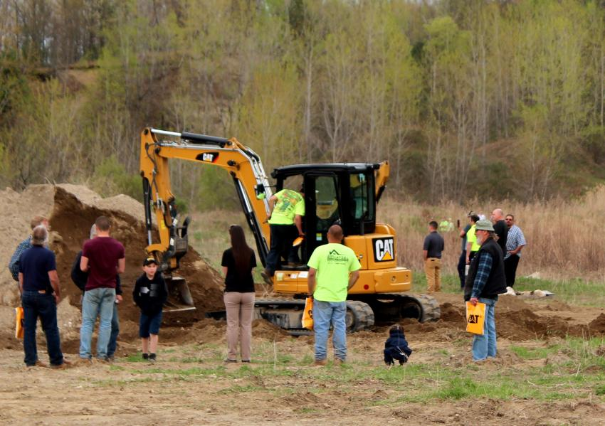 The Cat 305.5 mini-excavator draws a big crowd.