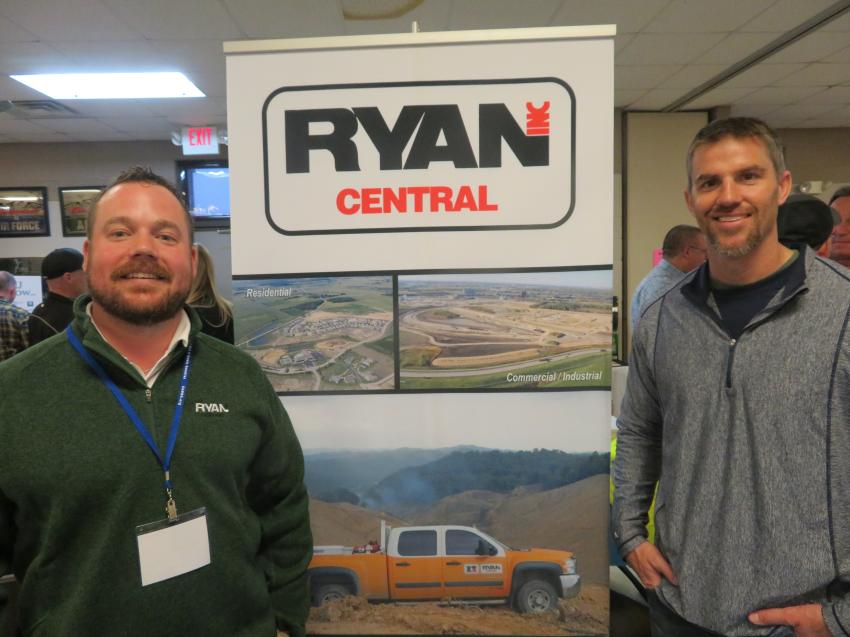 Ryan Central's Ladd Worple (L), business development, and Klint Kessling, general superintendent, stop for a photo.