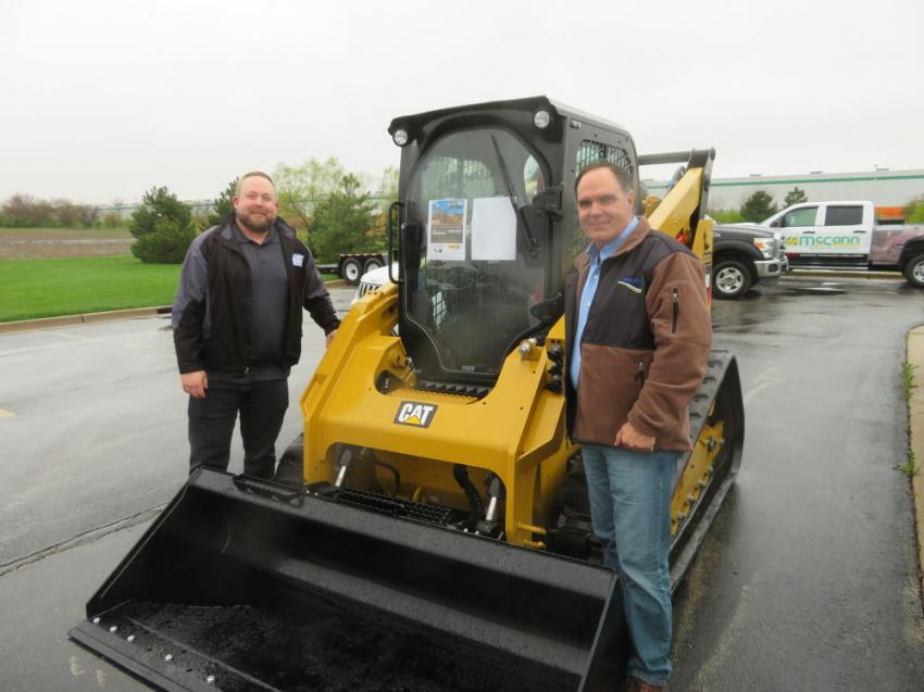 Matt Blacklock (L) and Dan Misischia of Welsch Ready Mix inspect this Cat 289D tracked skid steer from Altorfer Cat.
