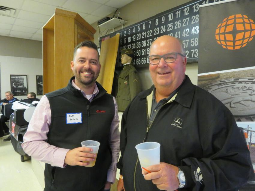 Matt Postema (L) of Ozinga Ready Mix catches up with Bob Baish, owner of Baisch Excavating Inc.