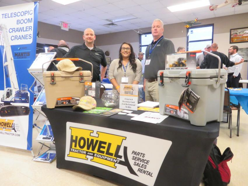 (L-R) are Aaron King, branch manager of Howell Tractor & Equipment LLC, Peru, Ill.; Liz Venegas, marketing employee of Howell Tractor & Equipment LLC,  Gary, Ind.; and  Todd DeMoss, product support sales representative, Peru, Ill.
