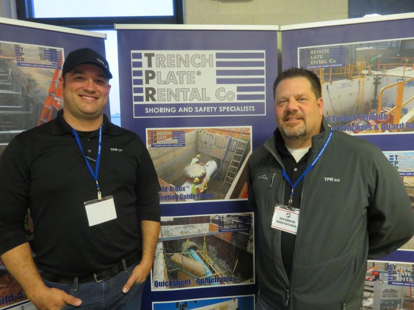 Sean Kerrins (L) and Joe Sleyko of Trench Plate Rental Co., Joliet, Ill., pose by their booth.