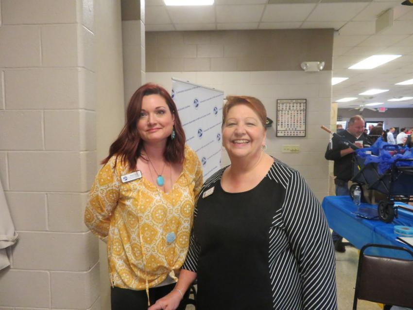 Karri Lane (L) and Mary Metz greet and register attendees for the annual expo in Joliet, Ill.