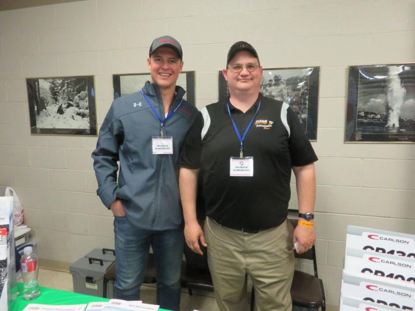 Ryan Carr (L) and JR Boerner welcome customers to the McCann Industries booth.