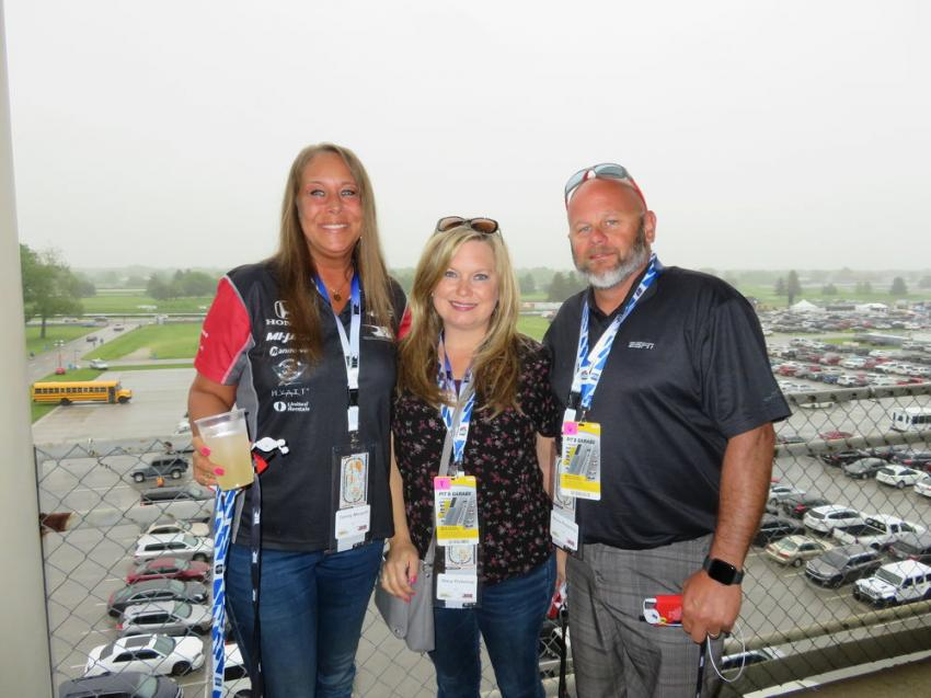 Getting ready to take a tour of pit row and the garage area (L-R) are Tammy Mangold, and Stacey and Bryce Pickering, all of SDI Inc.