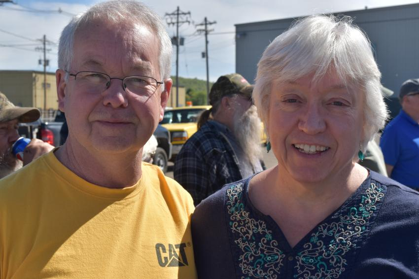 Milton Cat's Ricky Bullock and his wife, Bonnie, stopped by to enjoy the excitement of the auction and to monitor the prices of some of the Cat used iron.