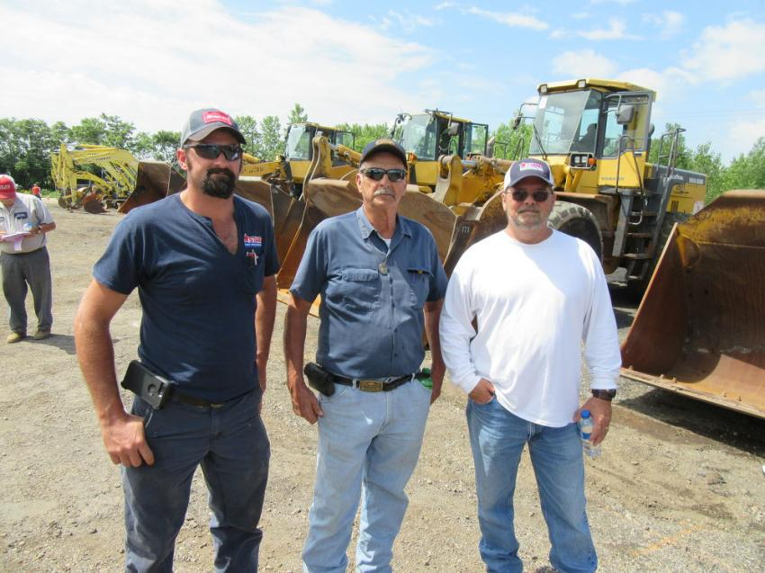 (L-R): Starr Parts & Equipment's Mark Francis is joined by his father, Bill, along with Starr Parts & Equipment President Butch McCaleb to take in the auction activities.