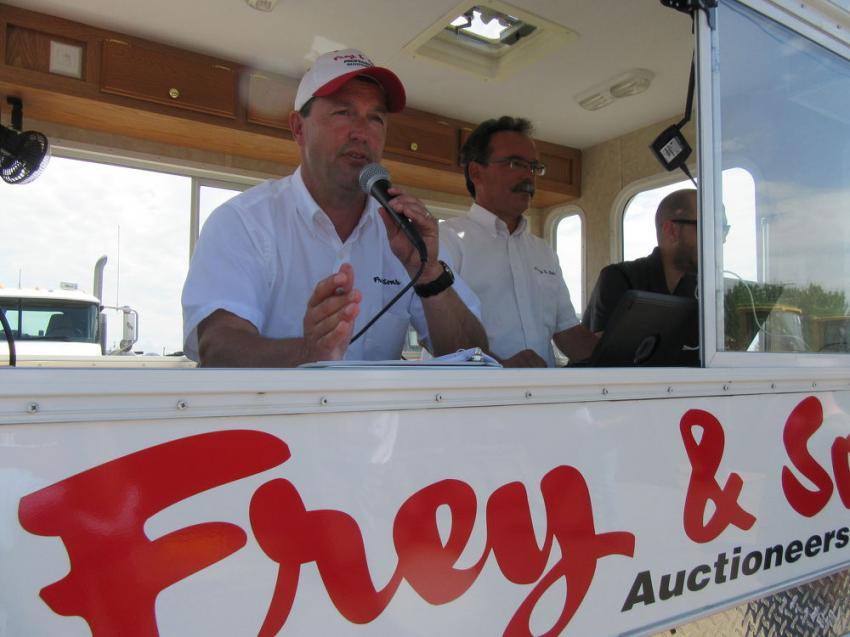Brothers Kevin (L) and Mark Frey, the two sons of Frey & Sons, teamed up to keep the bidding moving along smoothly and at a fast pace.