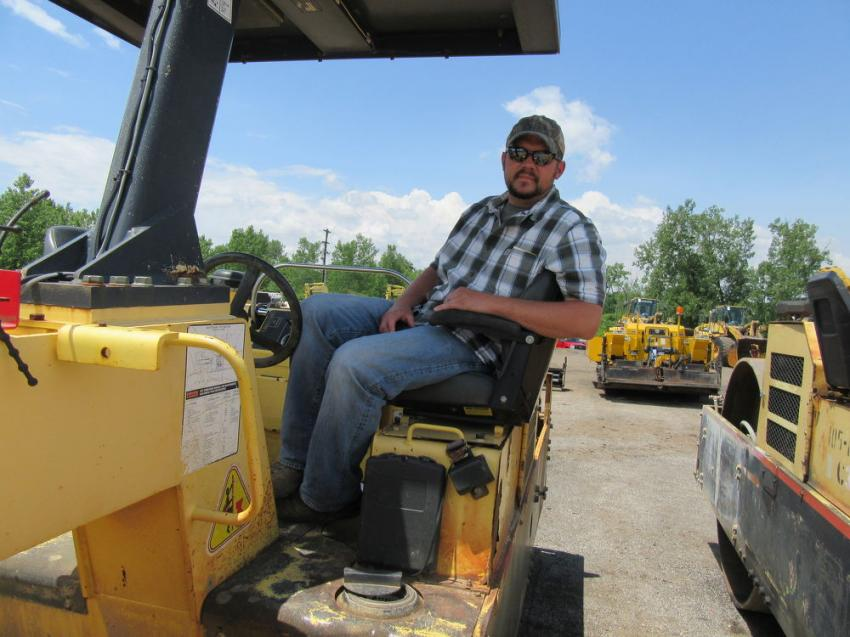 In from Wampum, Pa., Todd Youngblood of Youngblood Paving found a seat on a roller to wait until the tankers came up for bid.