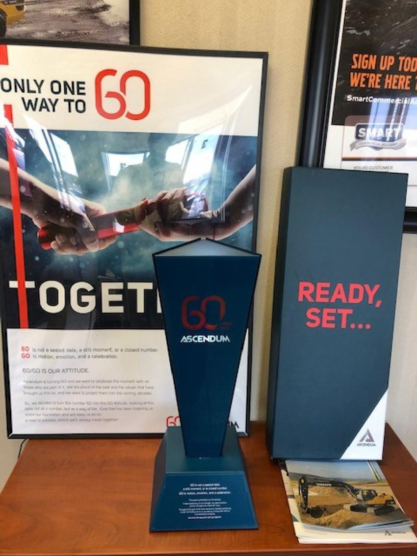The Ascendum 60-year torch and commemorative poster.