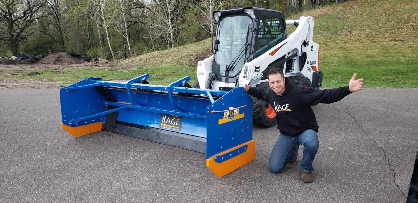 Mike Stephan, president, founder and inventor of Kage, poses with the Snowfire Snow Plow Box System for skid steers and compact wheel loaders.