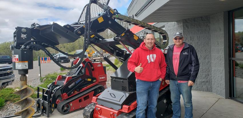 Checking out the new Toro TX 2000 are Mike Cambell (L), owner of Campbells Welding & Skidsteer Service, and  John Campbell, father of Mike and CEO.