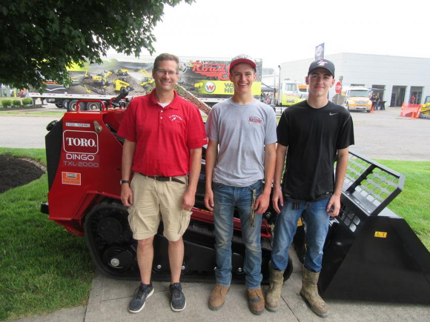 (L-R): All Ohio Masonry's Scott Thompson, along with son, Isaac, and his friend, Hunter Dickson, took a look at the Toro Dingo equipment display, including the TXL2000 compact utility loader at the event.