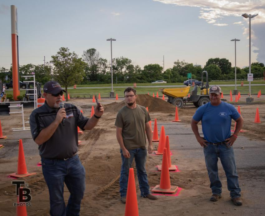 (L-R): Buck Tucker, store manager, announces the winners: DJ Steele (second place) and Jeff Foster (first place).