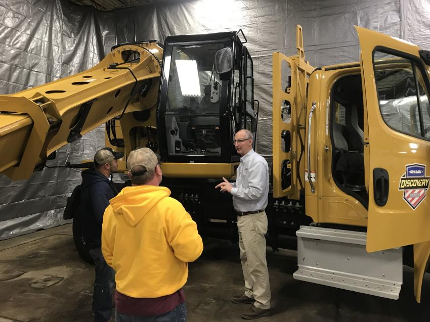 Gary Cain, Gradall representative, answers questions about the D154 highway speed excavator.