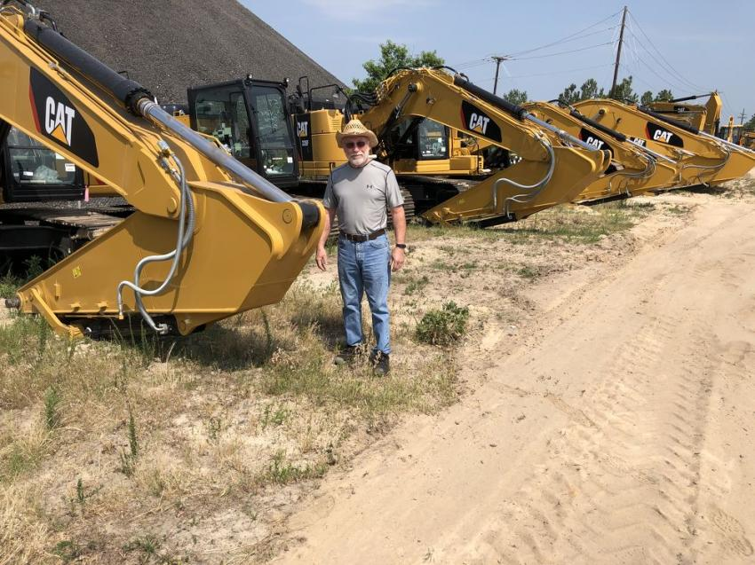 Art Young of Thompson Machinery in Nashville, Tenn., was looking over the Cat excavators.