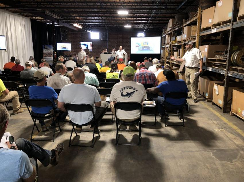 With temperatures in the high 90s outside, the bidders were kept cool inside. The items up for bid were shown on large monitors.