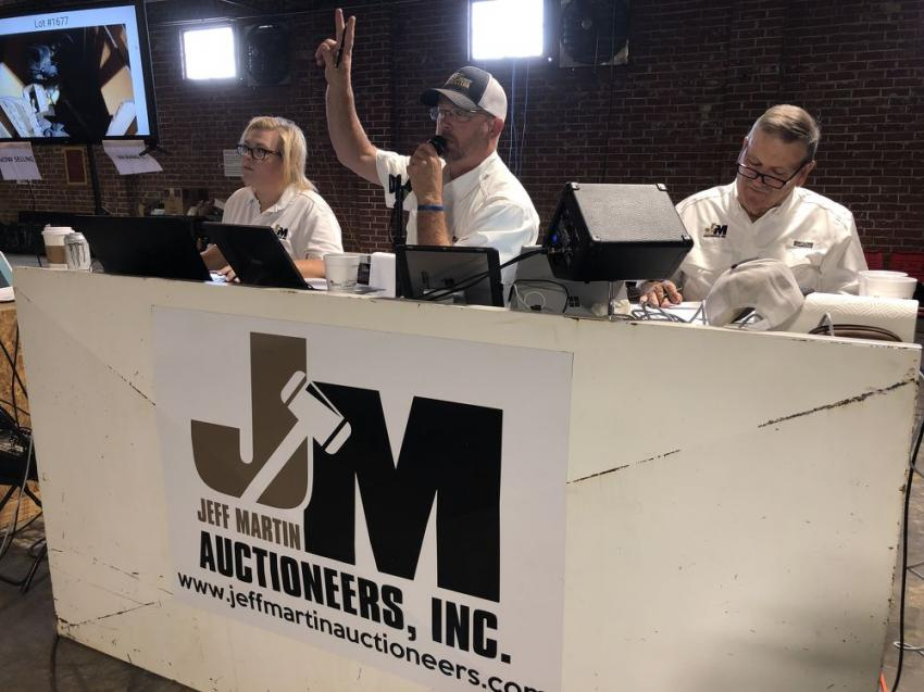 Keeping the auction flowing is Jennifer Martin, Ron Kries and Paul Martin.