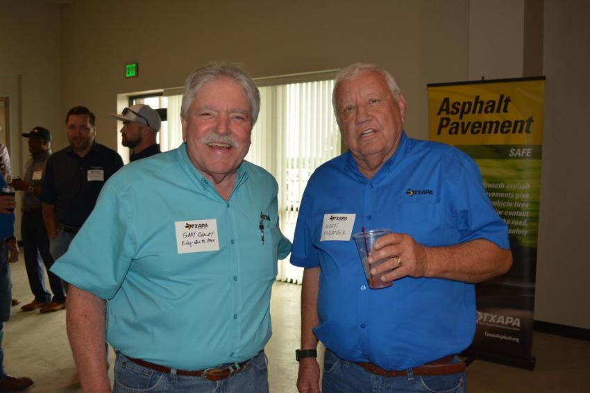 Albert Schlather (R), past president of TXAPA, was recognized for his efforts in expanding the organization's facilities. Kirby-Smith's Gary Corley was one of many to offer congratulations on the building's completion.