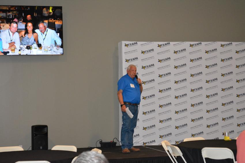Past president Albert Schlather addresses TXAPA members at the open house held on June 6 in Buda, Texas.