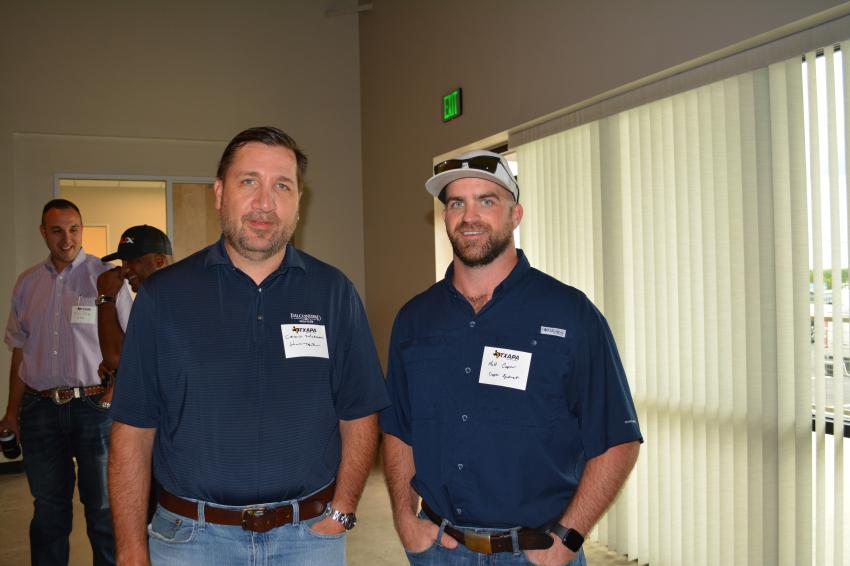 Craig Morgan (L) of Hunter Industries and Matt Cooper of Cooper Equipment were among the 150 attendees at the Texas Asphalt Pavement Association open house in Buda, Texas.