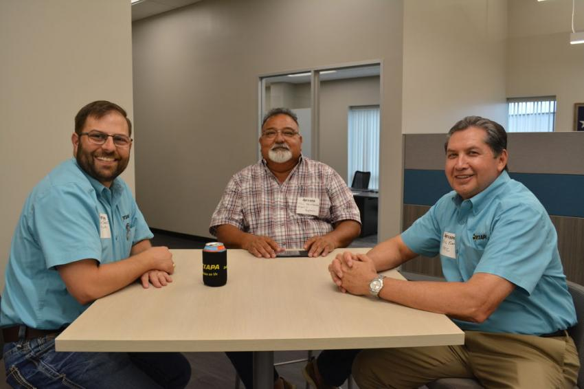 (L-R): Geno Carrier of East Texas Asphalt, Tom Hernandez of Martin Asphalt and Eric Suarez of Primoris Heavy Civil caught up during the open house.