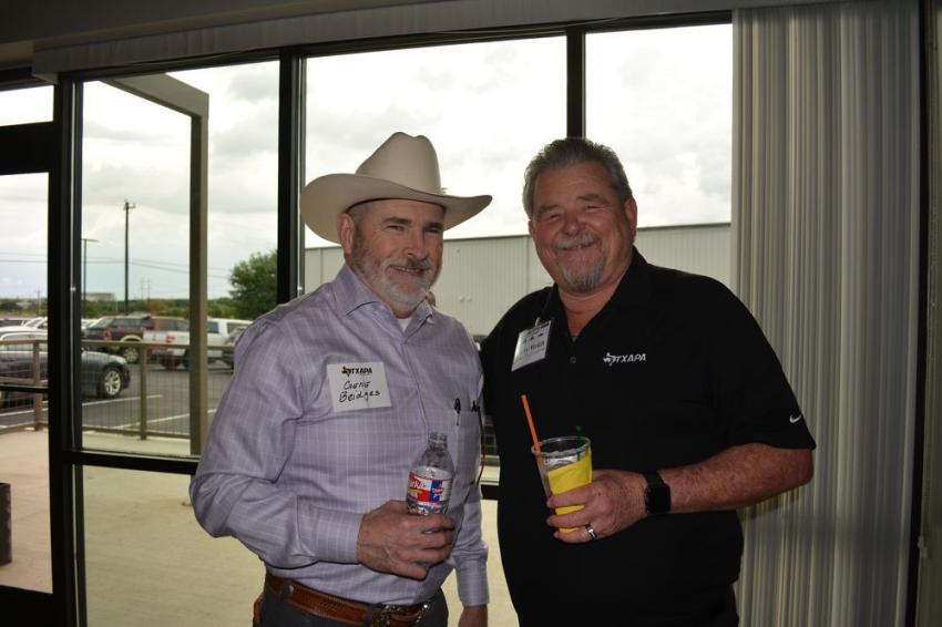 Envirotx VP of product development and compliance, Gene Bridges, (L) and Larry Welch, industry relations consultant of TXAPA, enjoyed the new facility.