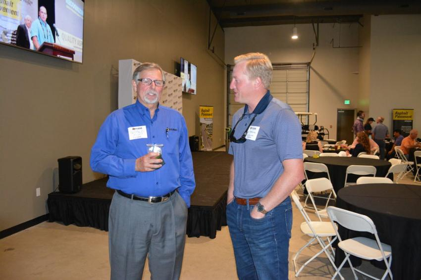Harold Mullin (L), TXAPA executive vice president, welcomes Scott Arthur of Constellation Energy to the organization's open house in Buda, Texas, on June 6.