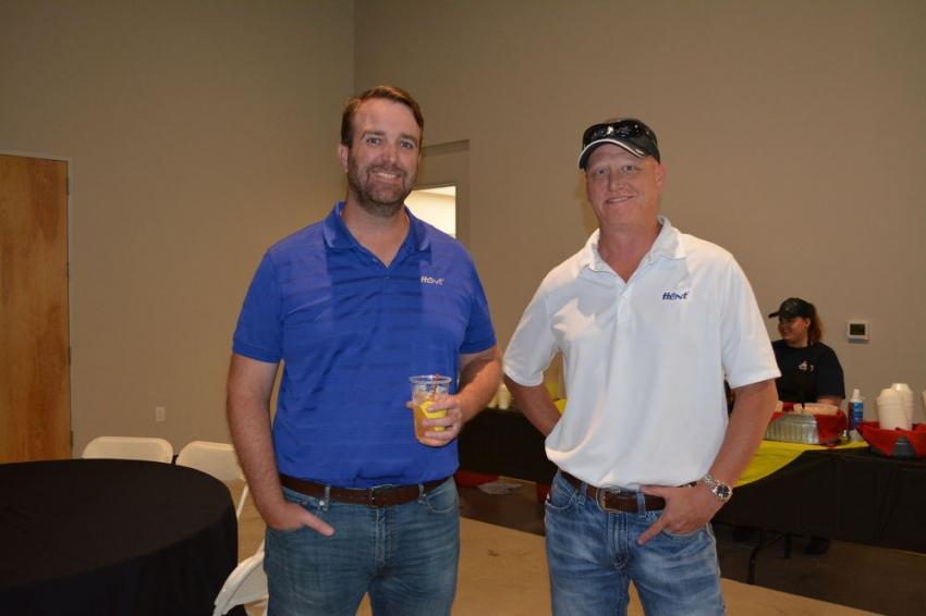 Jim McFarlin (L) and Trey Gosa of Hunt Refining visit TXAPA's new offices.
