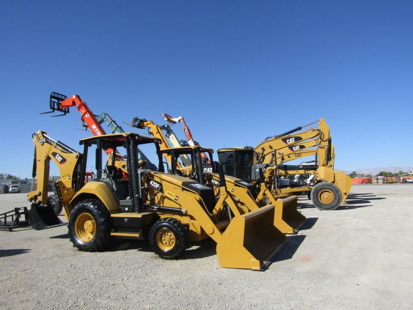 A variety of Cat backhoe loaders and excavators are ready to go to work.