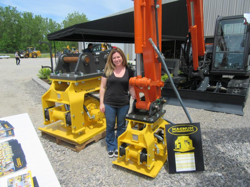 Tracy Bottrell of Magnum Attachments is seen here with two versions of the company's compactor attachments.