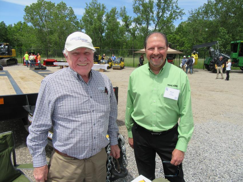 Eager Beaver Trailers' Jim Berryman (L) talks with Trail King's Mark Aller at the event.