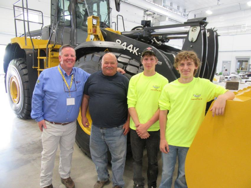 (L-R): Five Star General Manager of Orchard Park and Waterford, Bill McDonald thanked longtime customer and John Deere equipment fan, John Zoladz of Zoladz Construction Company, here with Noah Stachowiak and Michael Zoladz.