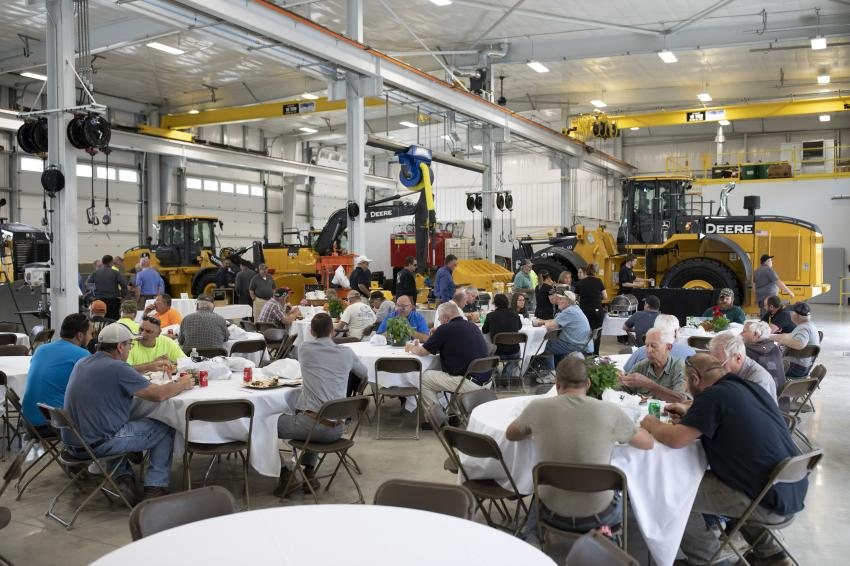 Guests enjoy lunch in the eight-bay service area, which is equipped with two 10-ton overhead cranes and a separate wash bay.