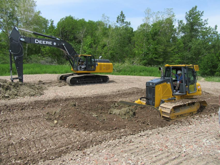In the outdoor demonstration area, Five Star Equipment Dunmore Branch General Manager Bill Bochicchio Jr. puts a John Deere 650K dozer equipped with Topcon grade control, through its paces.