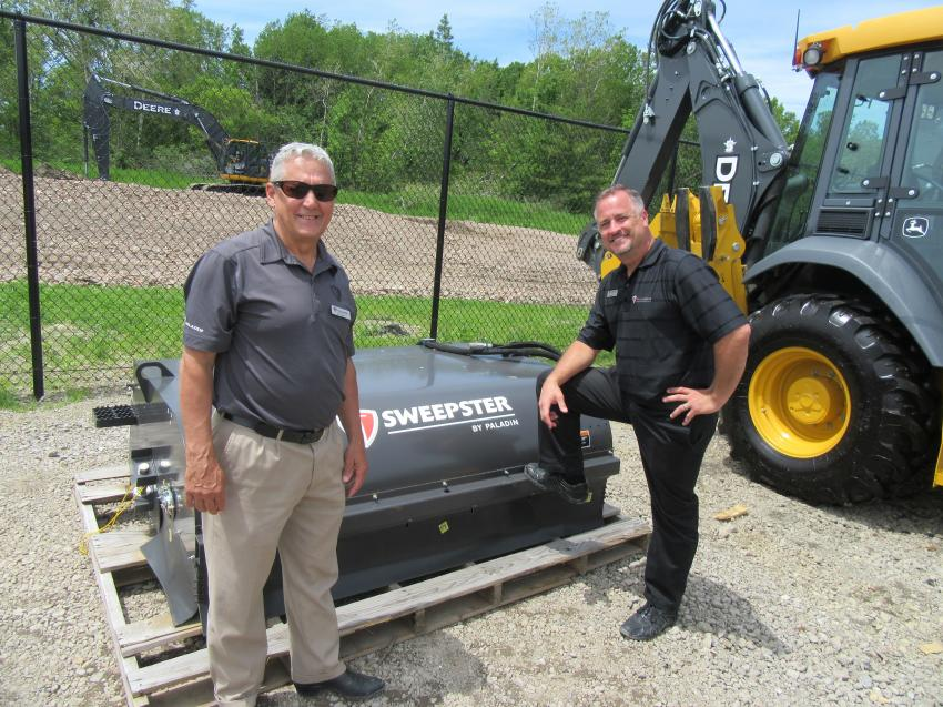 Paladin Construction Group's Ben Allgyer (L) and Christian Jarzab had a variety of attachments on display in the outdoor vendor area, including this Sweepster broom attachment.