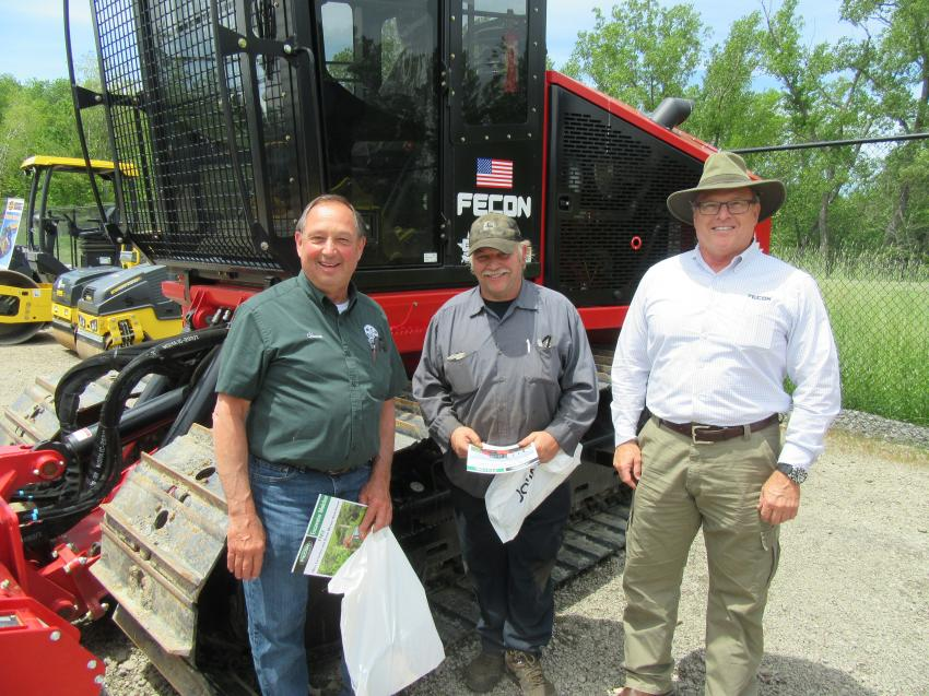 (L-R): Chuck McNiff and Roger Becker, both of the Town of Clarence, spoke with Fecon's Joe Cox about the company's wide range of land clearing equipment.