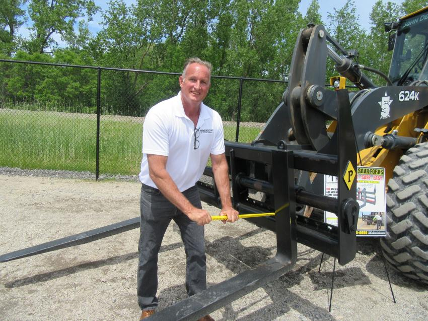 Pemberton's John Kinney demonstrates the company's recently introduced and innovative Bac-Savr forks, featuring a safe and easy way to adjust forks without risk of injury.