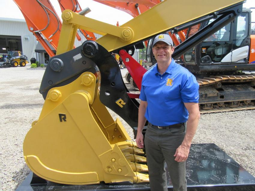 Rockland Manufacturing's Chris Person welcomes attendees to discuss the company's range of heavy construction buckets, grapples, rakes, blades, forks and thumbs.