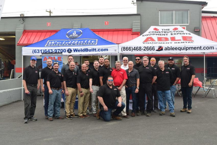 The ABLE Equipment team, including owner and founder and CEO Steve Laganas (seventh from R) poses for a photo during the June 6 open house in Allentown, Pa.