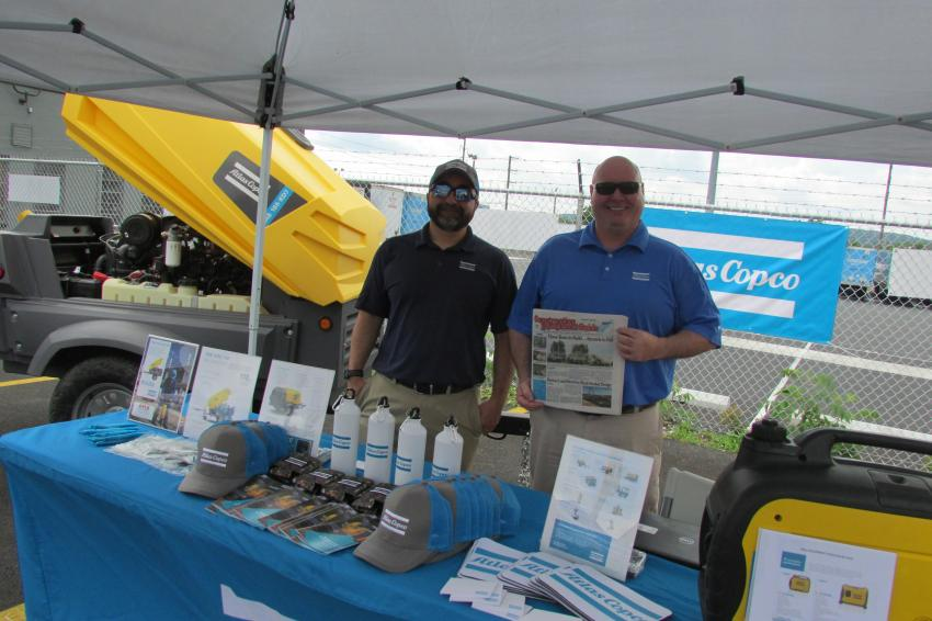 Reading Construction Equipment Guide during the ABLE Open House are Paul Scozzari (L), regional sales manager, and Patrick Donoghue, region sales manager, both of Atlas Copco.