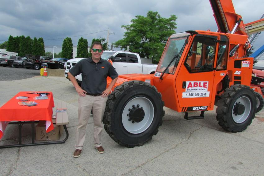 Adam Frank, district sales manager, is ready to discuss JLG lift with ABLE Equipment Open House guests.
