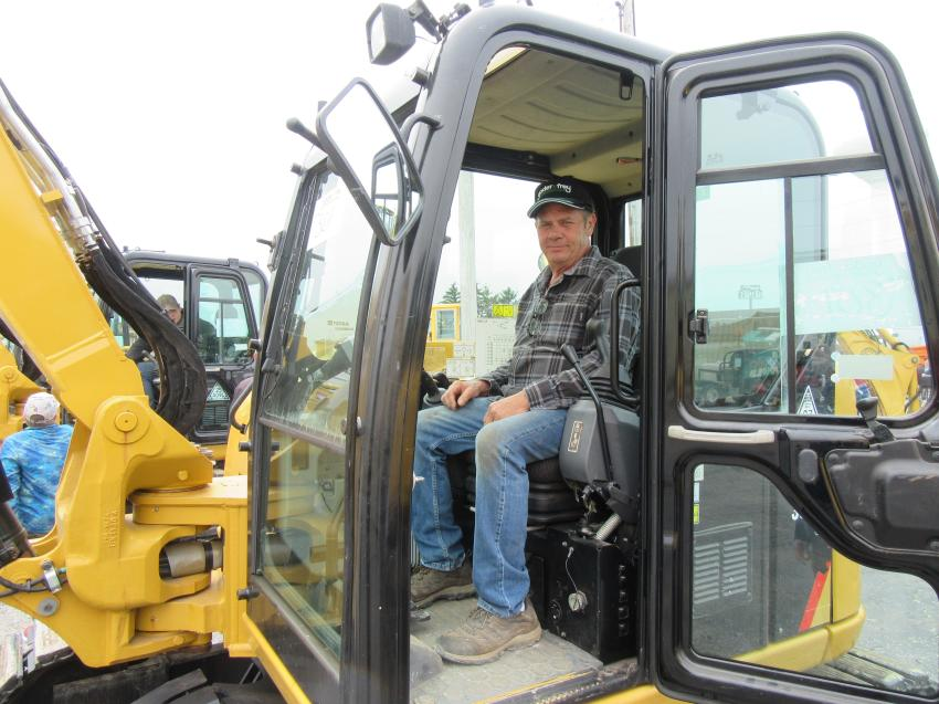 JP Simon of Warm & Dry Basement Systems tries out a Cat 308E 2CR excavator at the auction.