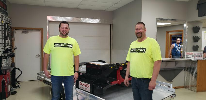 Chad Zirbes (L), retail sales & service, with Andy Nathe, retail trailer sales & service, talk about the wide variety of trailers and attachments Midsota manufactures in Avon Minn.