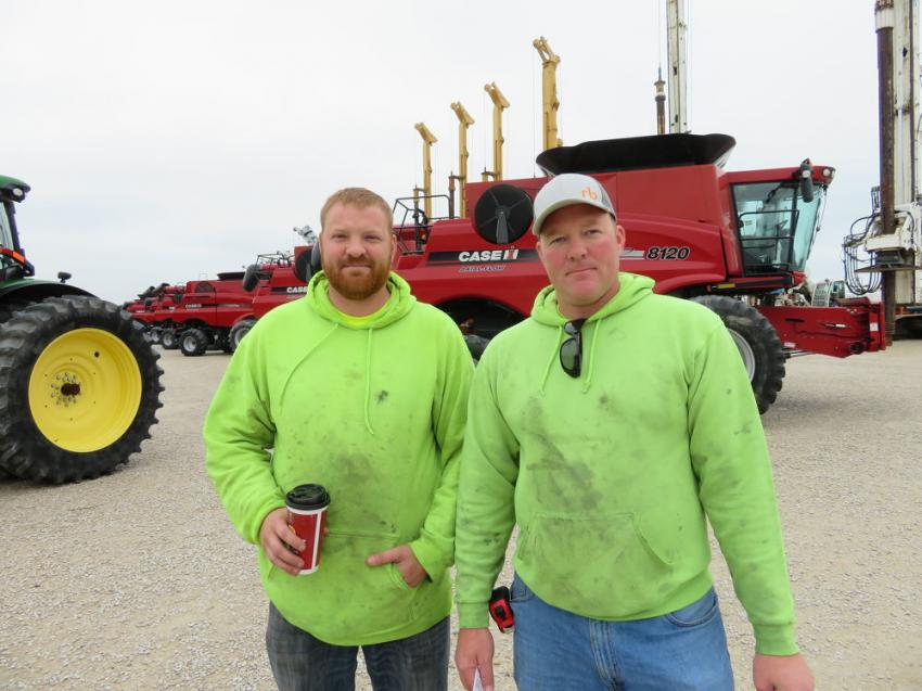 Rob and John Wellach of R.J.Wellach look over the iron at the June 20, 2019, auction in Morris, Ill.