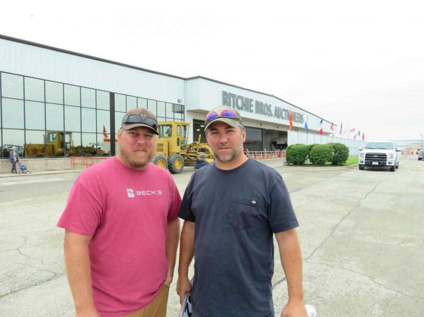 Jarrod Lunsford and Jason Grace of Grace Farms take a look at some of the farm equipment.