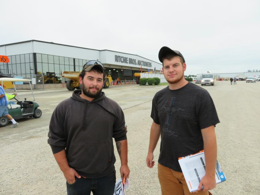 Doug Evely of Evely Constructions and Andrew Garcia of Garcia Contracting compare some notes at the auction.
