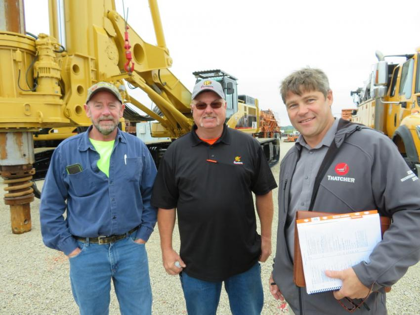 Glenn Rodd of Thatcher Foundations, Charles Hester of Aldridge Electric and Mike Wysockey of Thatcher Foundations look over the vertical drill rigs.