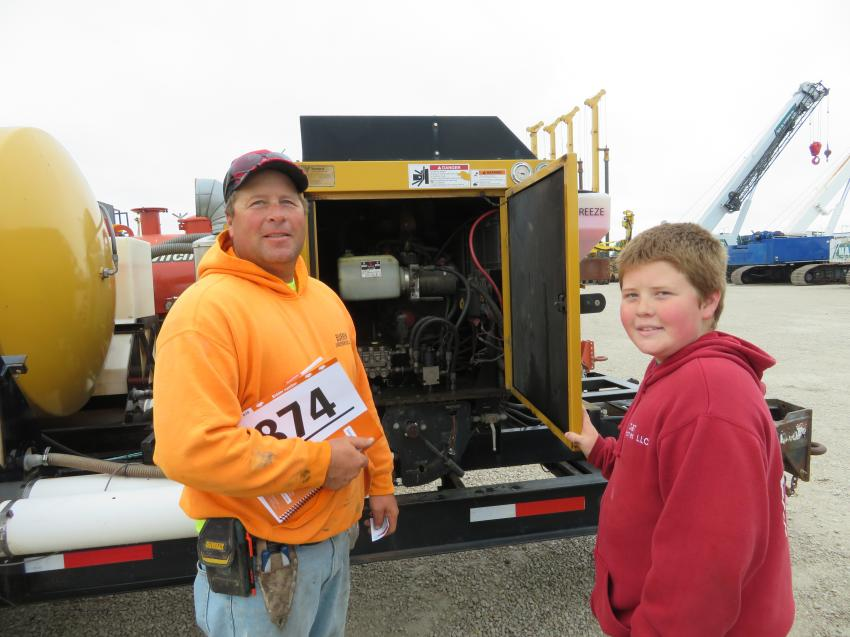 The father and son team of Dwaine and Sawyer of Burken Underground check out this Vermeer vacuum.